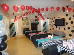 ikea birthday party diner scene with mini futons and ikea tables 1950s party