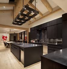 Kitchen With Bar Table - modern functional kitchen with bar and contemporary lighting