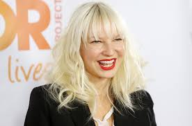 sia shows her face by going wig less in los angeles airport