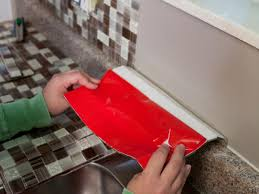 How To Install Glass Mosaic Tile Backsplash In Kitchen How To Install A Backsplash How Tos Diy