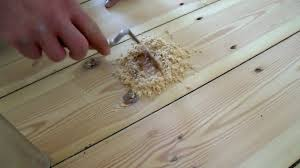 sanding floorboards hammering in nails cleaning gaps filling