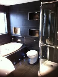 porcelain bathroom with recessed shelves jctiling