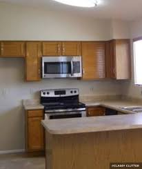 oak kitchen cabinets with stainless steel appliances painting kitchen cabinets before after