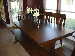simple two storey sourav dining table paired with decorative