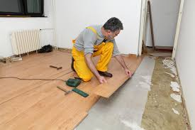 how to install laminate flooring around doors