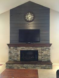 fireplace diy makeover old barnwood shiplap cleaned up and stained