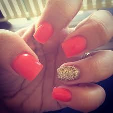acrylic nails fluro orange and gold glitter nails pinterest