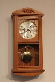light oak wall clock light oak wall clock with winding key in mint condition late 20th