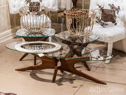 rustic farm tables w bench seating a vintage tv handmade jewelry