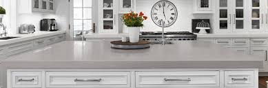 white kitchen cabinets with gray quartz counters custom countertops