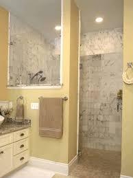 built in shower in white cabinet and glass door dark wood window