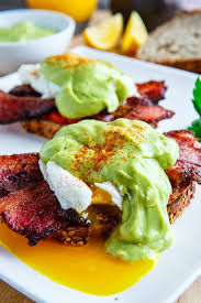 cuisine hollandaise eggs benedict with bacon avodaise avocado hollandaise and harissa