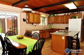 Painting The Kitchen 10 Stunning Farmhouse Kitchens With Coloured Cabinets The Happy
