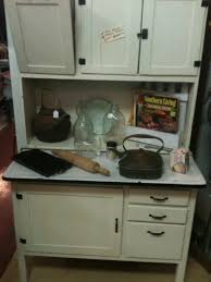antique hoosier cabinet with metal flour bin and metal bread