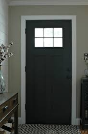 painted front door updating the entryway with sherwin williams iron ore little
