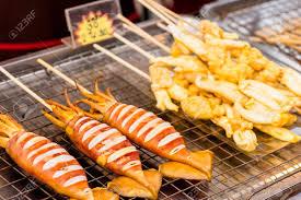 cuisine soldee grilled squid cooking food on food prepared or cooked