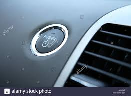 a toyota power button on a toyota prius hybrid car stock photo royalty