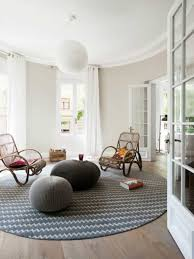 minimalist living room with rattan chairs and round area rug