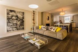 furniture open floor plan with modern sectional sofas and glass