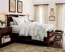 hip brown wooden master bed frames added white floral cover sheet