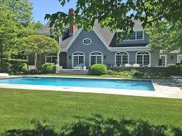 cottage swimming pool with french doors u0026 dormer window in east