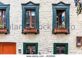 building facade with decorated white ogee arch windows and