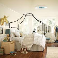 bedroom inspiring comfortable bed ideas for pbteens cozy wooden floor with flokati rug and comfortable canopy bed plus wall art for pbteens