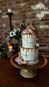 caramel drip cake wedding cake with flowers caramel and popcorn
