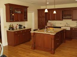brown wooden kitchen cabinets and island with granite countertop