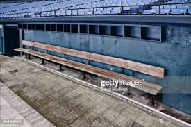 empty team bench in baseball dugout stock photo getty images