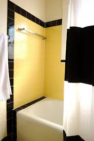 example of a small trendy master black tile white tile and yellow