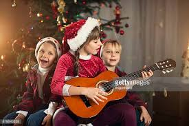 christmas songs for kids to sing stock photos and pictures getty