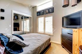 Small Bedroom Mirrors Small Bedroom With Mirror Door Closet Single Bed And Tv Stock