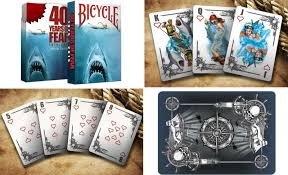 a jaws themed deck of cards is surprisingly more beautiful than gory