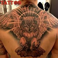 simple angry owl face tattoo on upper back with skull golfian com