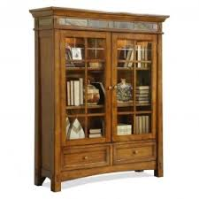 small bookcase with glass doors open travel