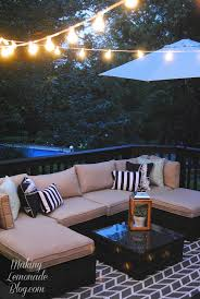 how to hang outdoor string lights on patio how to hang outdoor string lights the deck diaries part 3