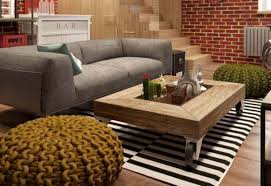 basement living room designs with grey couch and wooden top coffee