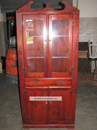 furniture curio cabinet with dark wood material and wooden