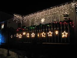 christmas light installation calgary christmas light hangers for gutters with mesh or perforated gutter