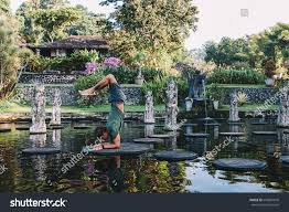 young man practicing yoga during luxury stock photo 645681649