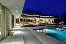 energy star home flanked by pool u0026 pond