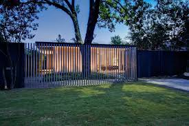 Front Yard Metal Fences - modern front yard landscape with metal fence post lights