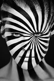 photos of faces painted in bold black white designs