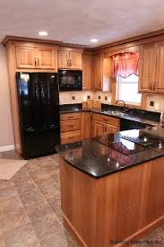 light brown kitchen cabinets with black appliances 15 kitchen with black appliances ideas kitchen remodel