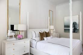 tall brass mirrors over nightstand transitional bedroom