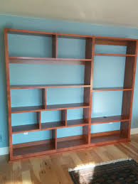 cherry wood corner bookcase offset shelves for a bookshelf display and tv stand trimmed out