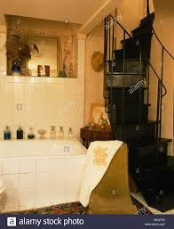 Bathroom In French by Black Spiral Staircase In French Country Bathroom With White Tiled
