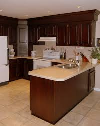Crown Moulding Kitchen Cabinets by Cherry Kitchen With Two Piece Crown Molding And Paneling To Cover