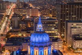 city lights at town center aerial view of san francisco city hall at night with golden state
